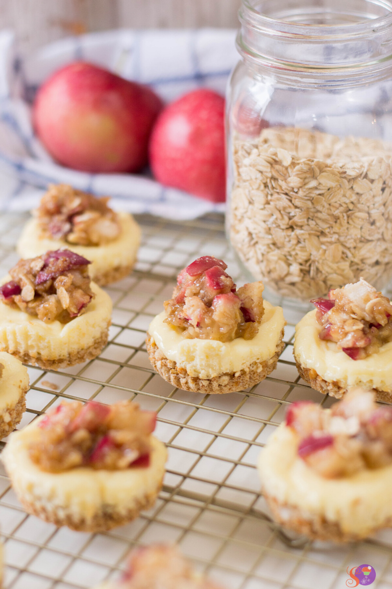 Mini Apple Crumble Cheesecakes on a rack