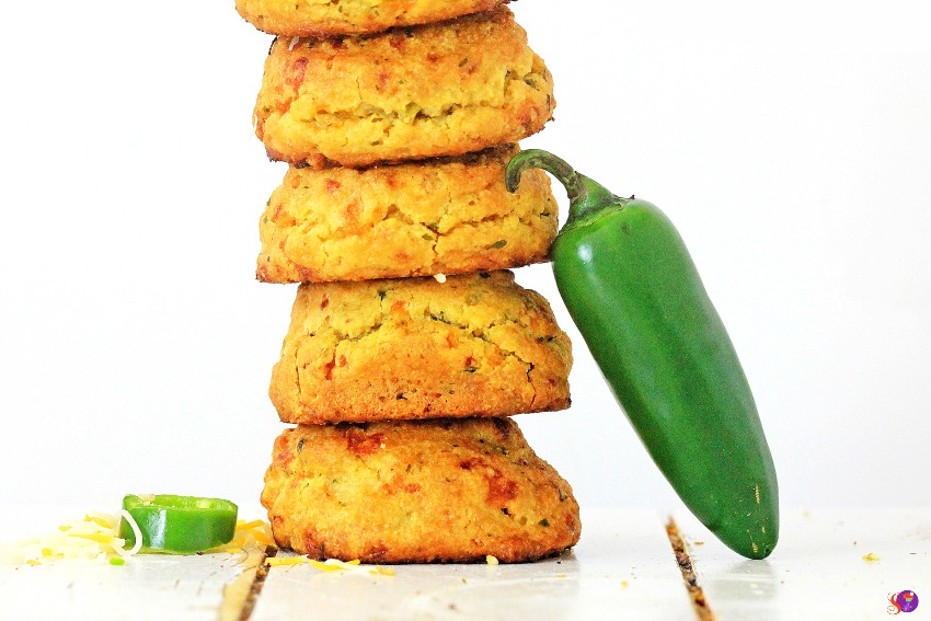 Jalapeño Cheddar Biscuits stacked on plate