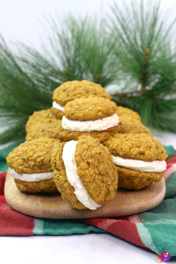 Light and fluffy homemade vanilla filling is sandwiched between two soft and chewy pumpkin oatmeal cookies to make a perfectly spiced Pumpkin Oatmeal Cream Pie!