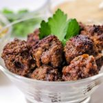 meatballs sitting in a clear bowl on table