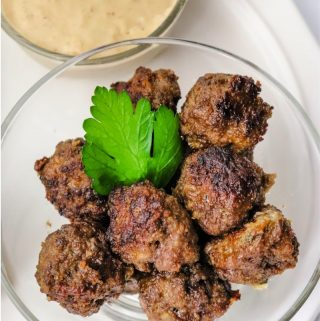 Meatballs in a bowl with Swedish Meatball Gravy on the side