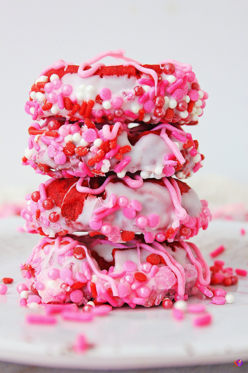 Valentine Thumbprint Cookies stacked on plate