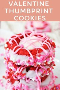 Valentine cookies with red dough, dipped in white chocolate and sprinkles, with white chocolate pink hearts, are a tasty little Valentine's Day treat!