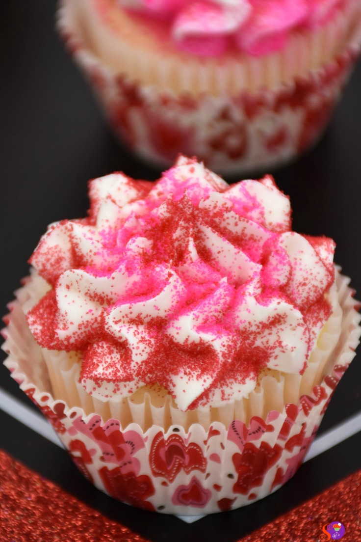 Rich vanilla cupcakes topped with a delicate homemade vanilla buttercream frosting and colorful sprinkles, these delicious Valentine's Cupcakes are filled with flavor and so easy to make. They're the perfect treat for the one you love!