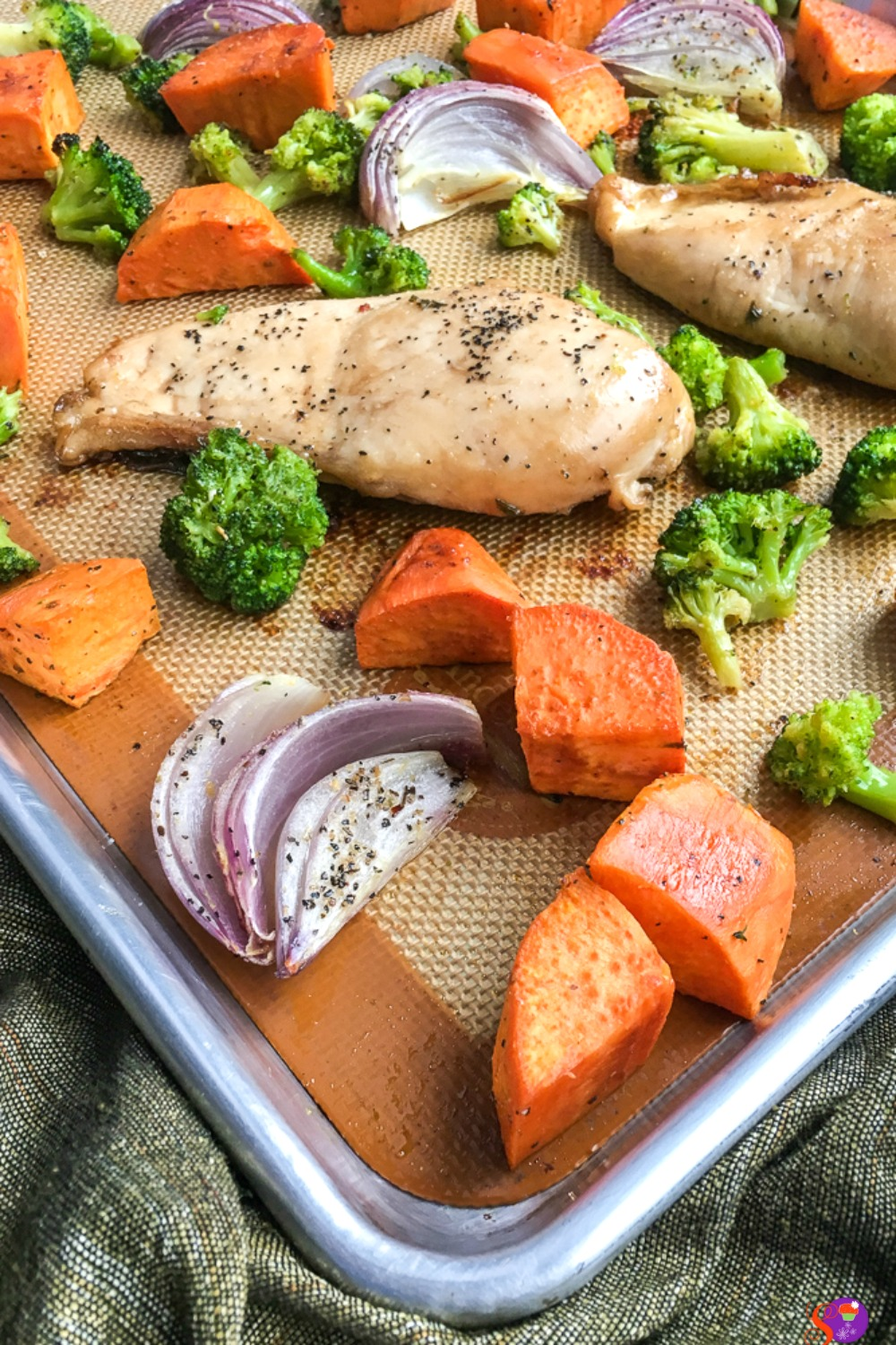 This delicious one-sheet dinner combines sweet potatoes, broccoli, red onion, carrots, and chicken breasts with a slightly sweet homemade balsamic marinade that practically begs to be eaten!