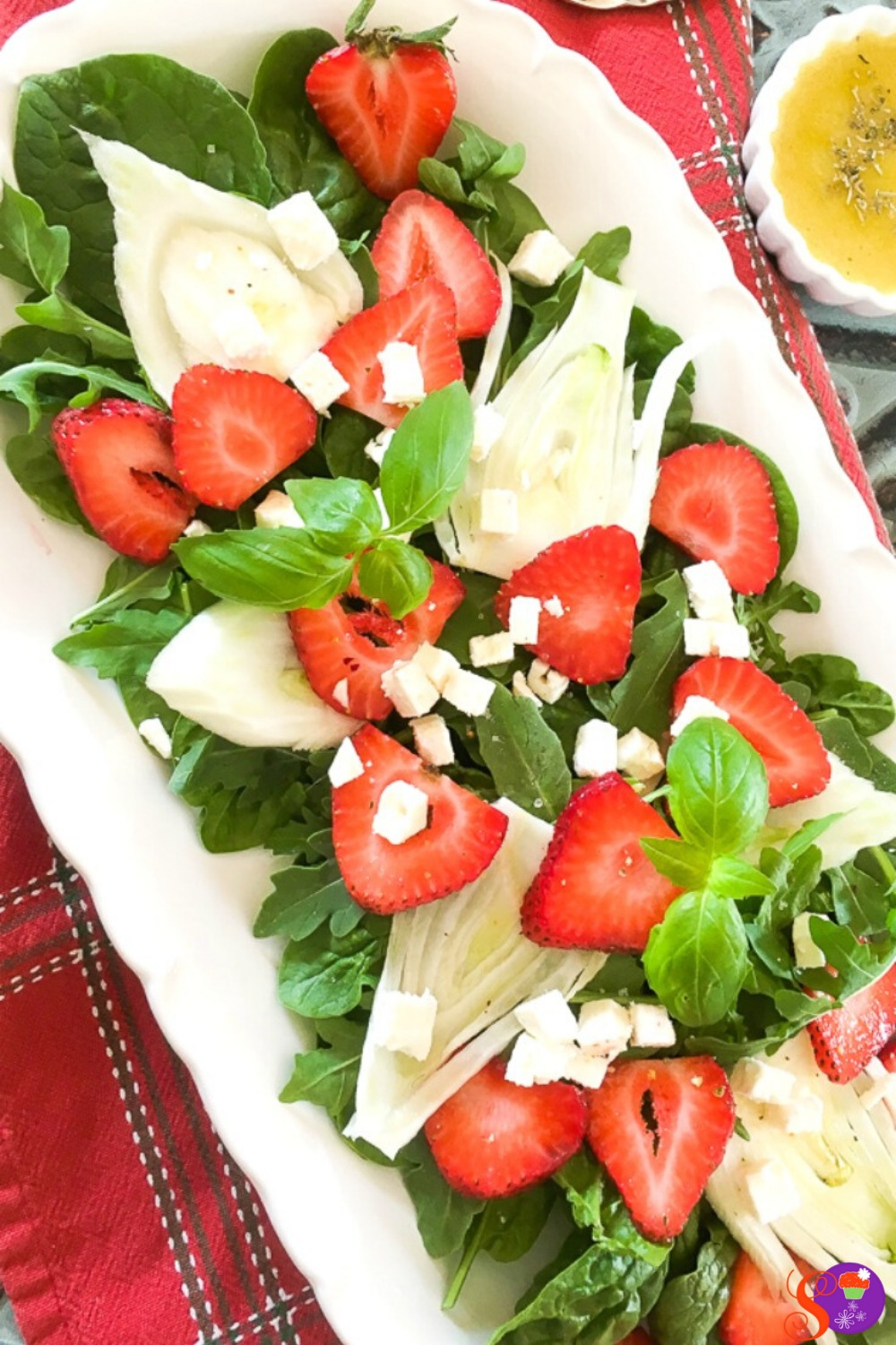 A delightful mixture of fresh baby spinach, arugula, juicy strawberries, crisp fennel, and feta cheese, this salad has a great balance of savory and sweet, crunchy and creamy soft. And, once it's topped off with my savory homemade balsamic dressing, it's packed full of flavor.