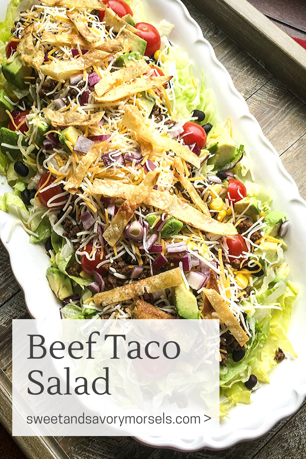 Seasoned beef, black beans, juicy grape tomatoes, creamy avocado and sweet corn,  fresh lettuce, cheese, and crispy tortilla strips are all combined to perfection in this easy Beef Taco Salad recipe.