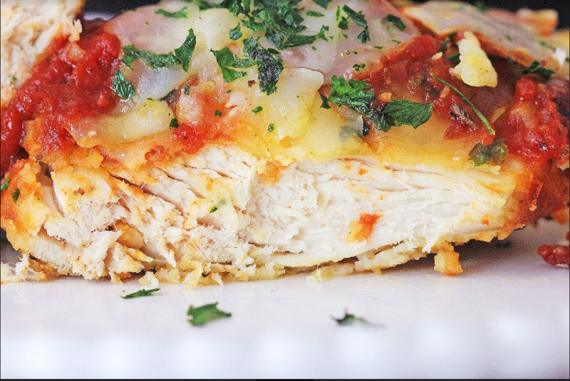 Chicken Parmesan cut on a plate