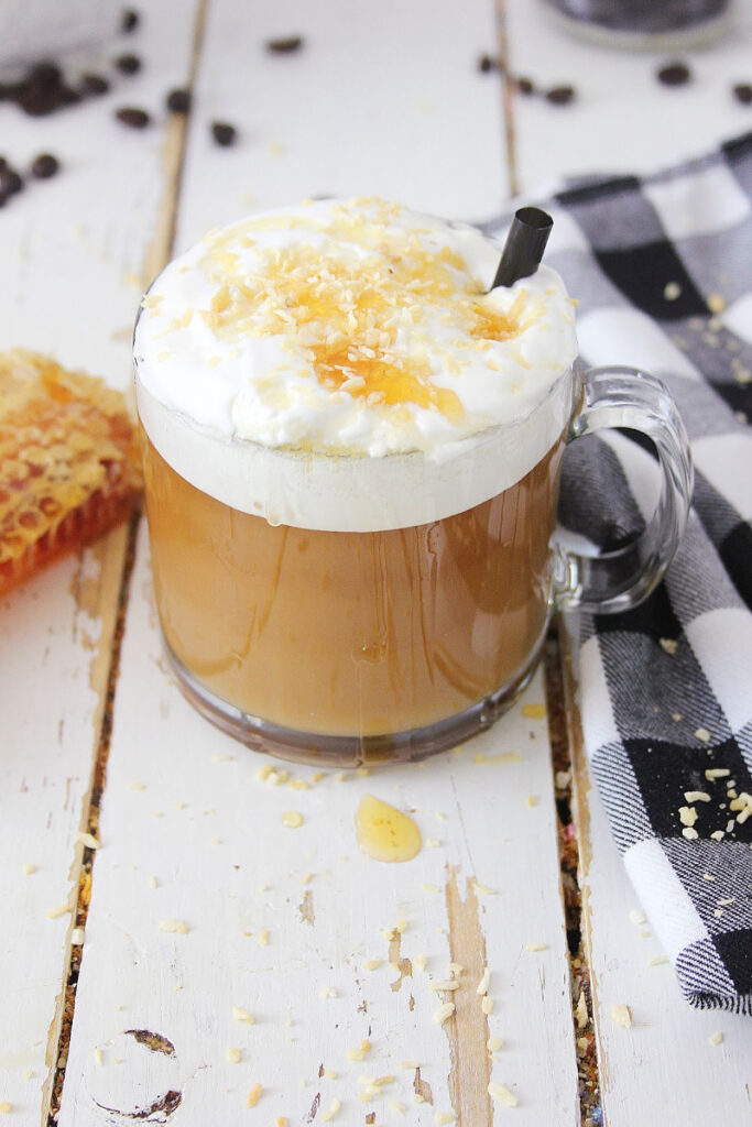 Toasted Coconut Honey Latte sitting on table with black and white checkered napkin