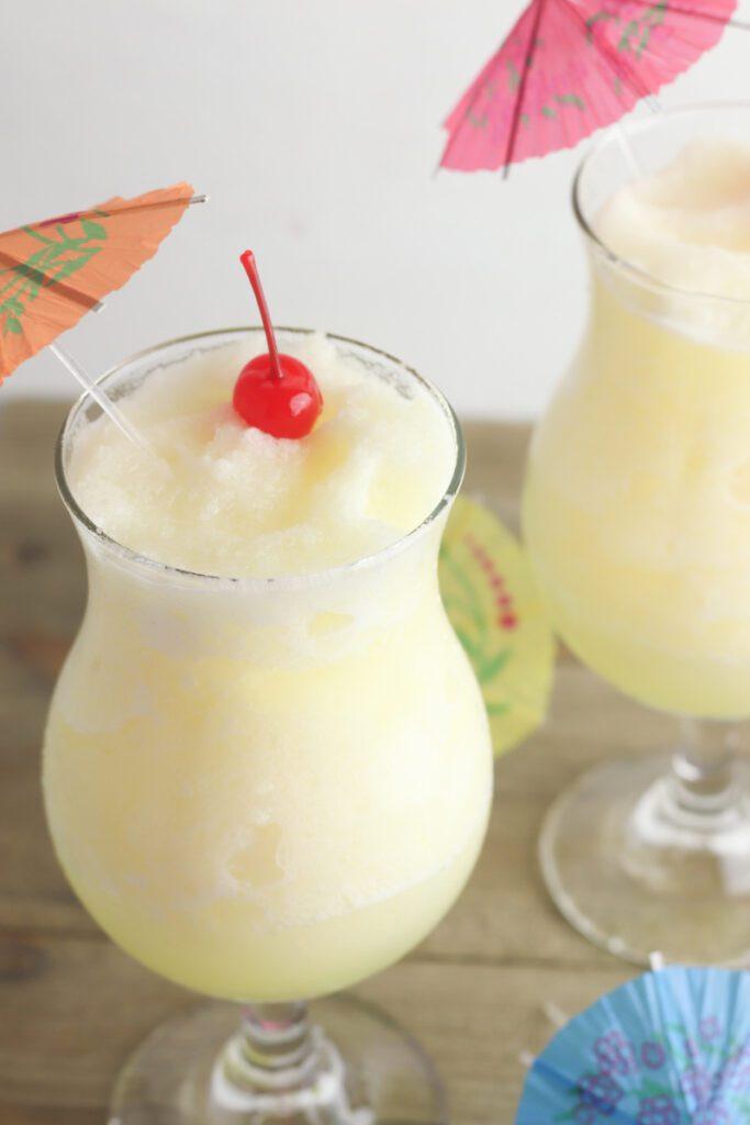 frozen pineapple lemonade in a tall glass