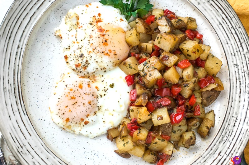 easy Skillet Parmesan Breakfast Potatoes served with eggs
