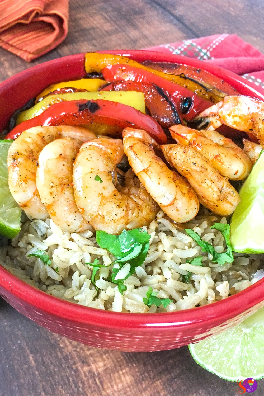 Full of perfectly-seasoned tender shrimp and fresh vegetables and served over a bed of cilantro-lime rice, this Shrimp Fajita Bowls with Cilantro-Lime Rice is sure to become a favorite